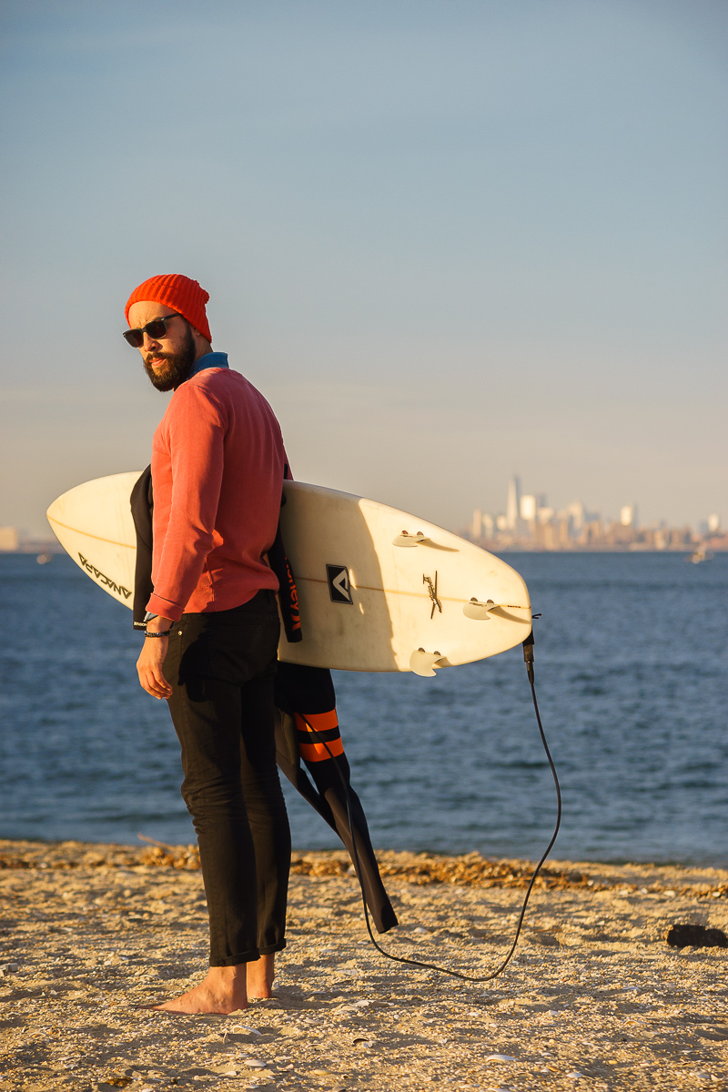 Image of a surfer look man with a surfboard