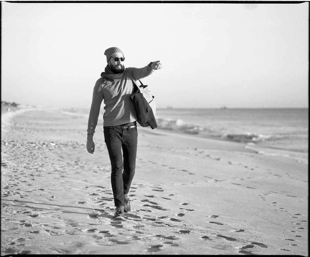 Surfer look man walking on the beach