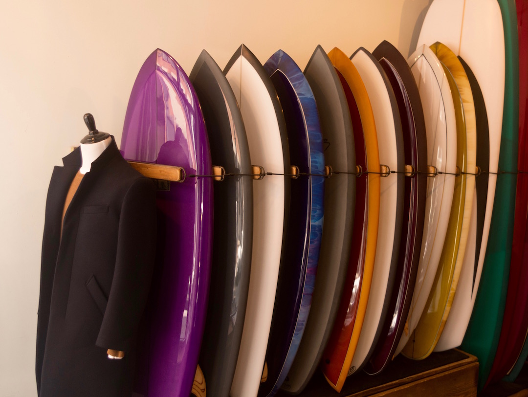 An image of topcoat and surfboards in Saturdays NYC Crosby Street store