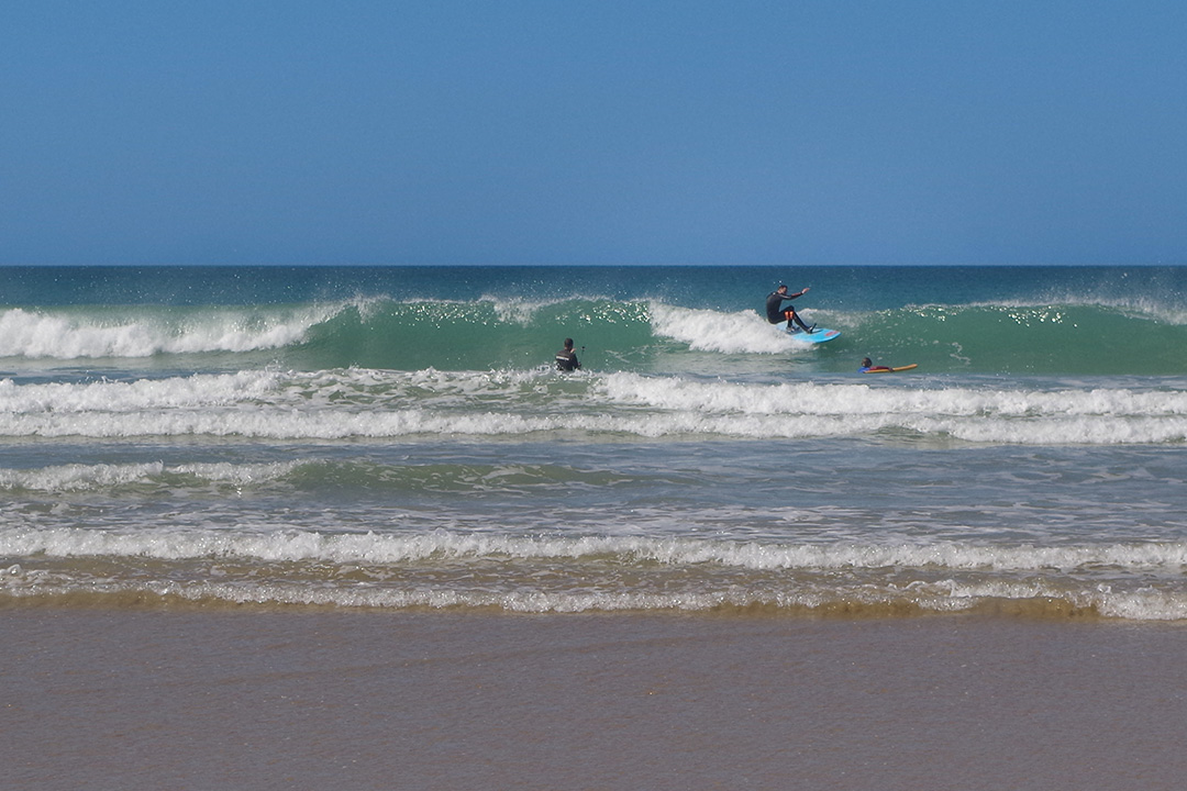 Picture of a surfer riding the wave in Conil, Spain
