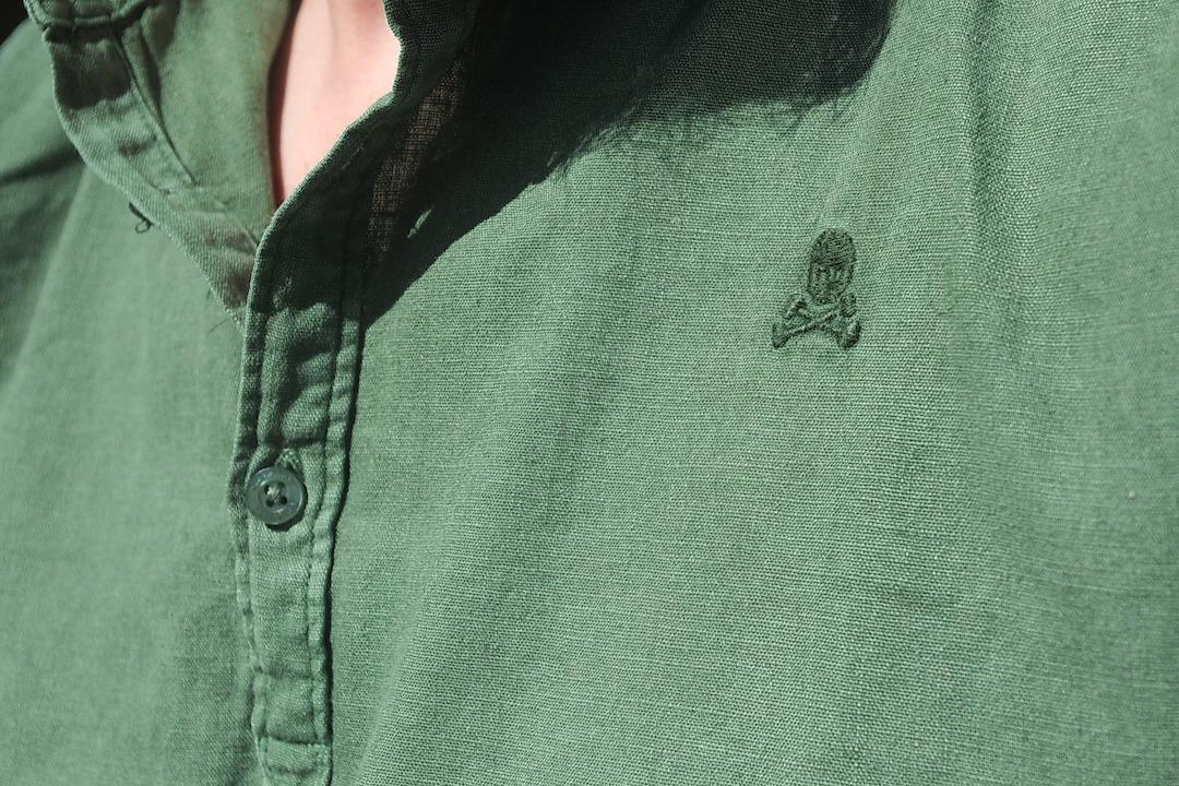 A picture of a Scalpers green linen shirt