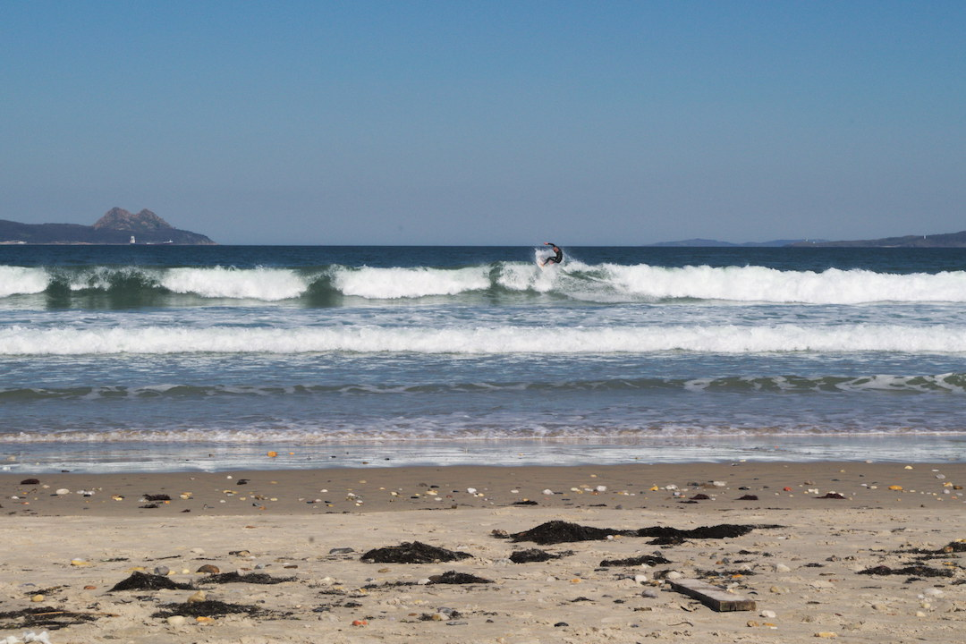 Picture of a surfer on Patos beach in Galicia