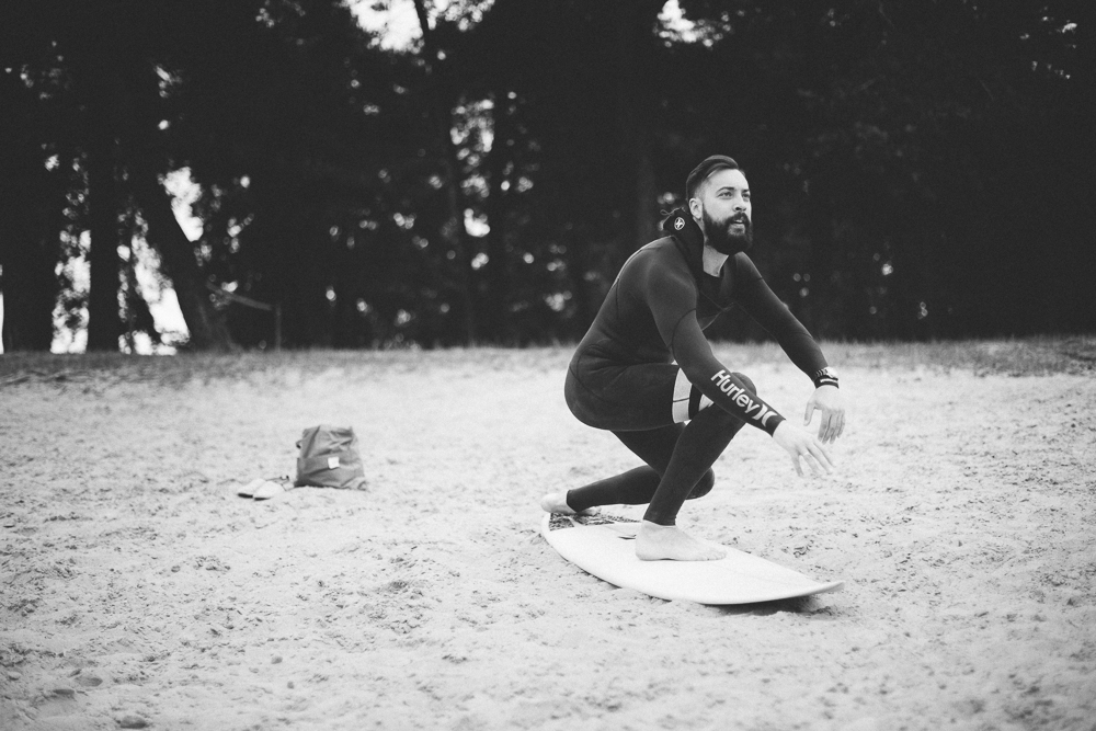 Picture of a surfer warming up on a beach
