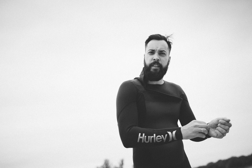Picture showing a surfer in his Hurley Fusion 302 wetsuit