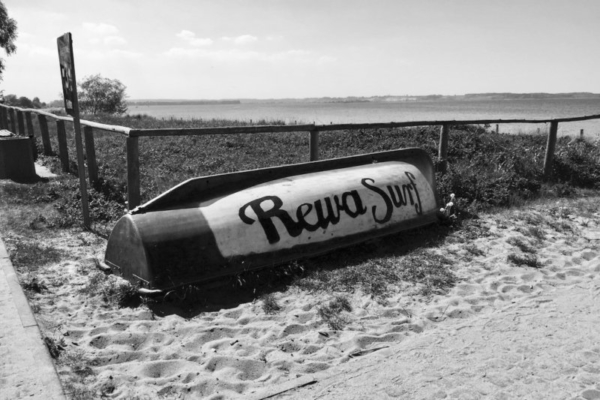 an old boat on the beach in Rewa, Poland