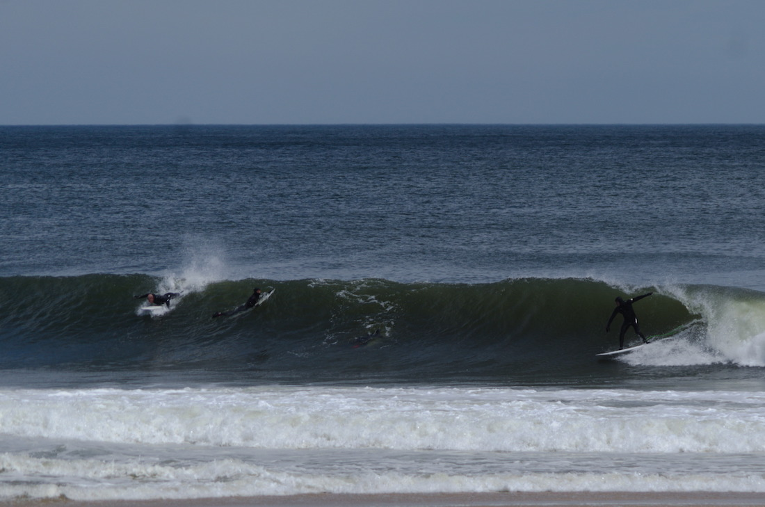 surfers on Jersey shore