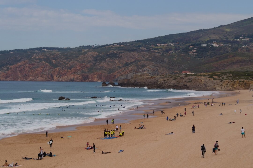 Bathers and surfers at Guincho beach